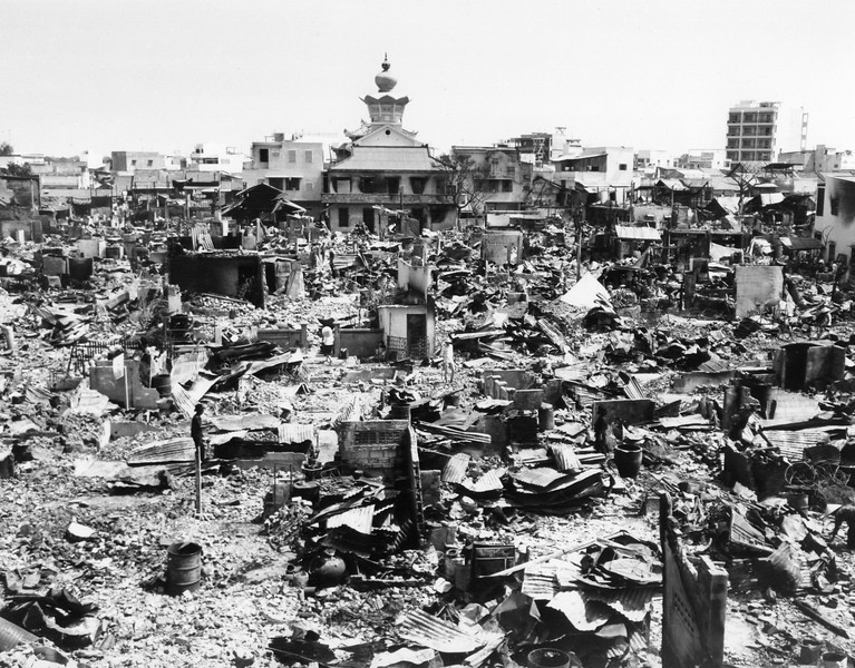 Description of  A large section of rubble is all that remained in this one block square area of Saigon on Feb. 5, 1968, after fierce Tet Offensive fighting.  Rockets and grenades, combined with fires, laid waste to the area. An Quang Pagoda, location of Viet Cong headquarters during the fighting, is at the top of the photo. (AP Photo/Johner)