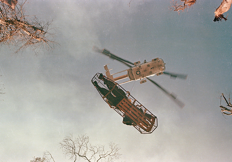 Description of  A helicopter lifts a wounded American soldier on a stretcher during Operation Silver City in Vietnam, March 13, 1966.  (AP Photo)
