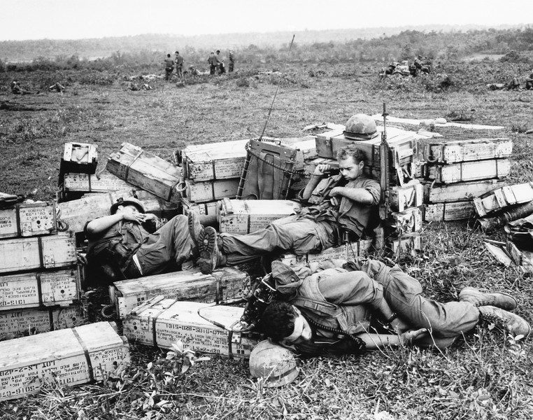Description of  Three American marines sleep atop ammunition boxes during a pause in the fighting at Gio Linh on April 2, 1967, just south of the demilitarized zone in Vietnam. (AP Photo)