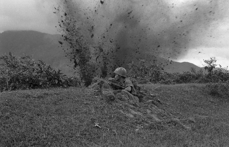Description of  Unaware of incoming enemy round, a South Vietnamese photographer made this picture of a South Vietnamese trooper dug in at Hai Van, South of Hue, Nov. 20, 1972. The camera caught the subsequent explosion before the soldier had time to react. The incident occurred during one of many continuing small scale fire fights in South Vietnam, despite talk of a forthcoming ceasefire. (AP Photo)