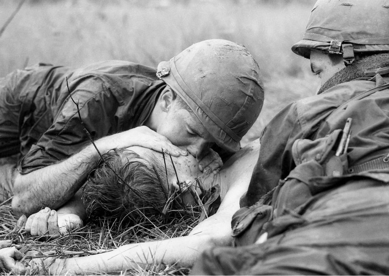 Description of  Medic James E. Callahan of Pittsfield, Mass., gives mouth-to-mouth resuscitation to a dying soldier in war zone D, about 50 miles northeast of Saigon, June 17, 1967. Thirty-one men of the 1st Infantry Division were reported killed in the guerrilla ambush, with more than 100 wounded.  (AP Photo/Henri Huet)