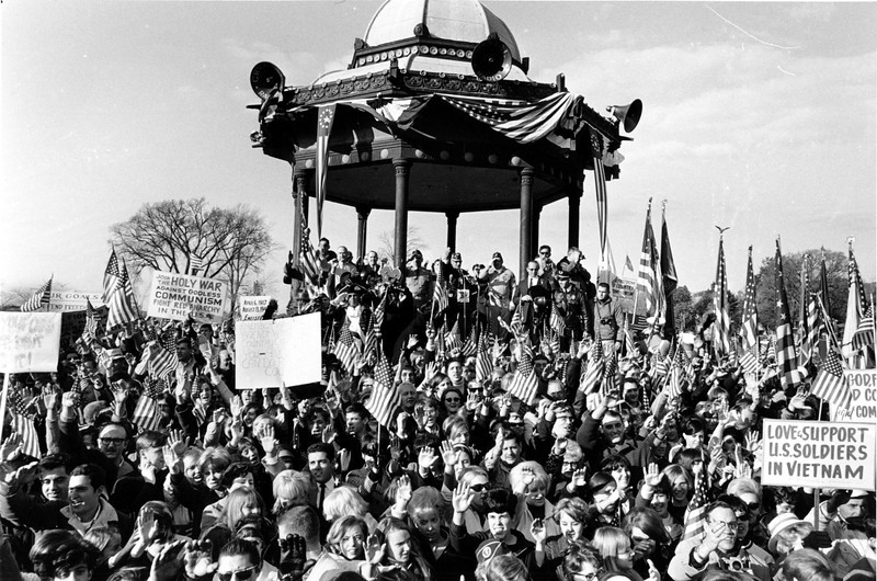 "Description of  Part of a crowd of pro-Vietnam War demonstrators hold up signs and American flags in support of U.S. policy in Vietnam in Wakefield, Mass., on Oct. 29, 1967.  The demonstration was organized by 19-year-old Paul P. Christopher, a Wakefield high school senior who became ""burned up"" by anti-Vietnam War demonstrators.  (AP Photo/J. Walter Green)"