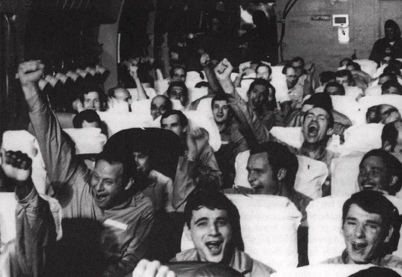 Description of  Jubilation as a C-141 takes off from Hanoi on March 28, 1973 heading home. (GNS Photo by Historical Office, Office of the Secretary of Defense)