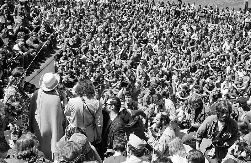 Description of  Vietnam veterans opposed to the war assemble on the steps of the Capitol in Washington, April 19, 1971, to protest the U.S. action in Indochina.  Addressing the crowd is Rep. Bella Abzug (D-NY), wearing hat.  (AP Photo)