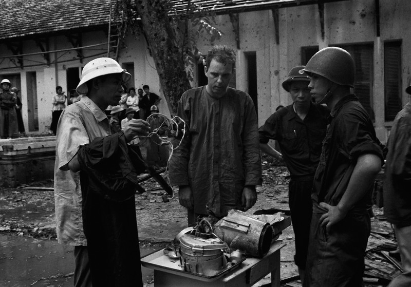 Description of  William Morgan Hardman is interrogated by North Vietnamese military authorities in front of Hoan Kien Hospital in Hanoi, Vietnam on Aug. 24, 1967. Hardman, a U.S. pilot, was captured after his plane was shot down. (AP Photo)