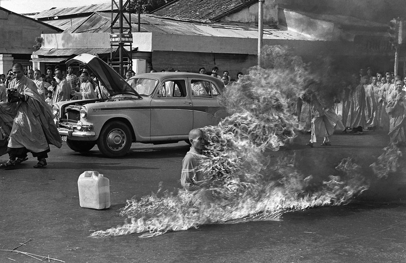 Description of  Quang Duc, a Buddhist monk, burns himself to death on a Saigon street on June 11, 1963, to protest alleged persecution of Buddhists by the South Vietnamese government. (AP Photo/Malcolm Browne, File)