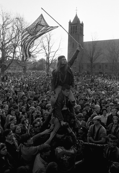 "Description of  Local members of the ""Hell's Angels"" motorcycle club form a human pyramid to wave flag and lead cheers at rally supporting American men fighting in Vietnam. A crowd estimated by police at near 25,000 turned out for the rally held this on October 29, 1967 on Wakefield, Massachusetts, common.  (AP Photo/J Walter Green)"