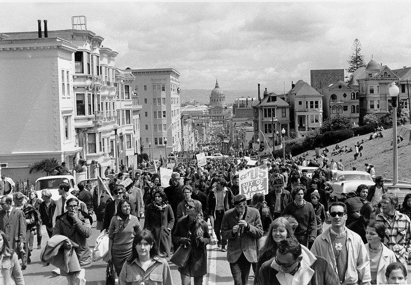 Description of  Anti-Vietnam war demonstrators fill Fulton Street in San Francisco on April 15, 1967. The five-mile march through the city would end with a peace rally at Kezar Stadium. In the background is San Francisco City Hall.  (AP Photo)