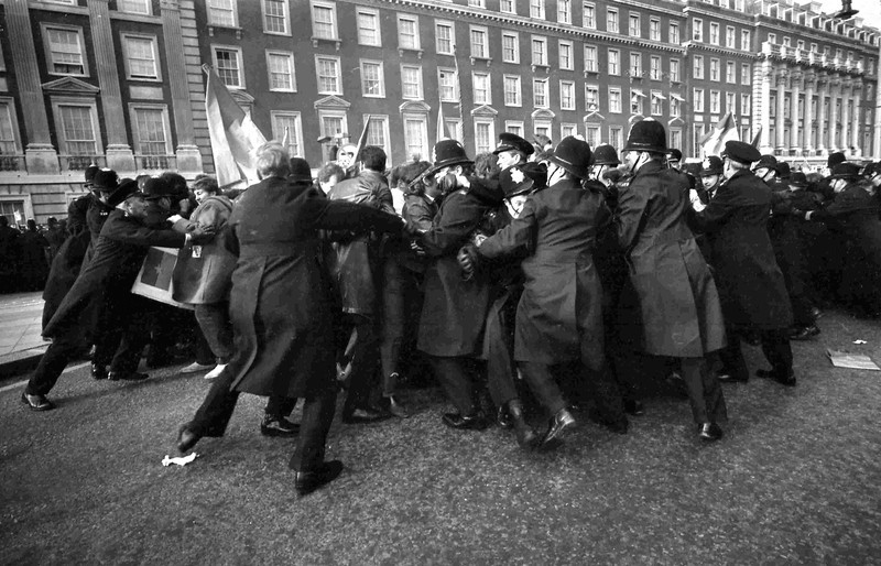 Description of  Police struggle with anti Vietnam War demonstrators outside the Embassy of the United States in Grosvenor Square, London, Mar. 17, 1968. (AP Photo)
