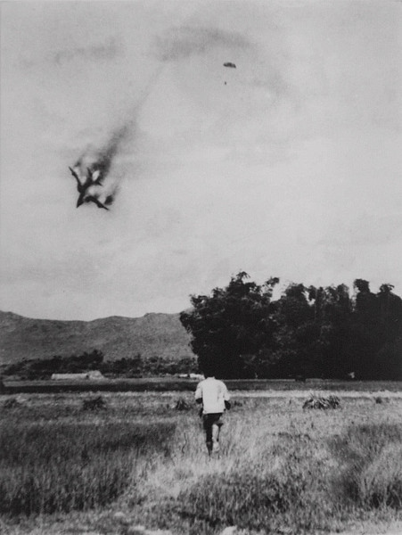 Description of  An American F-105 warplane is shot down and the pilot ejects and opens his parachute in this photo taken by North Vietnamese photograper Mai Nam on September 1966 near Vinh Phuc, north of Hanoi. This photo is one of the most recognized images taken by a North Vietnamese photographer during the war. The pilot of the aircraft was taken hostage and held in a Hanoi prison from 1966 to 1973. (AP Photo/Pioneer Newspaper/Mai Nam)