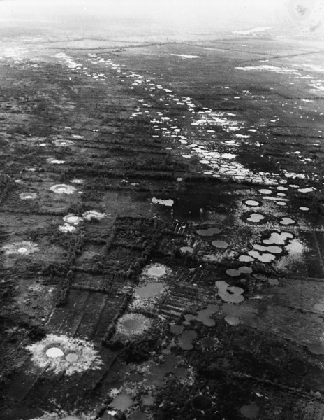 Description of  Water-filled bomb craters from B-52 strikes against the Viet Cong mark the rice paddies and orchards west of Saigon, Vietnam, 1966.  Most of the area had been abandoned by the peasants who used to farm on the land. (AP Photo/Henri Huet)