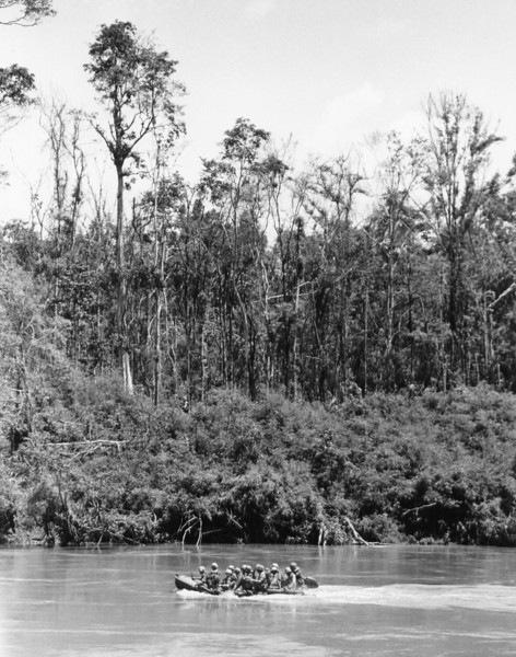 Description of  Paratroopers of the 173rd U.S. airborne brigade make their way across the Song Be River in South Vietnam en route to the jungle on the North Bank and into operation Sioux City in the D Zone on Oct. 4, 1966. Troopers and equipment were flown in by helicopter to the central highlands area, but the choppers couldn't land in the D zone jungles. The operation began late in the week of September 25. (AP Photo)