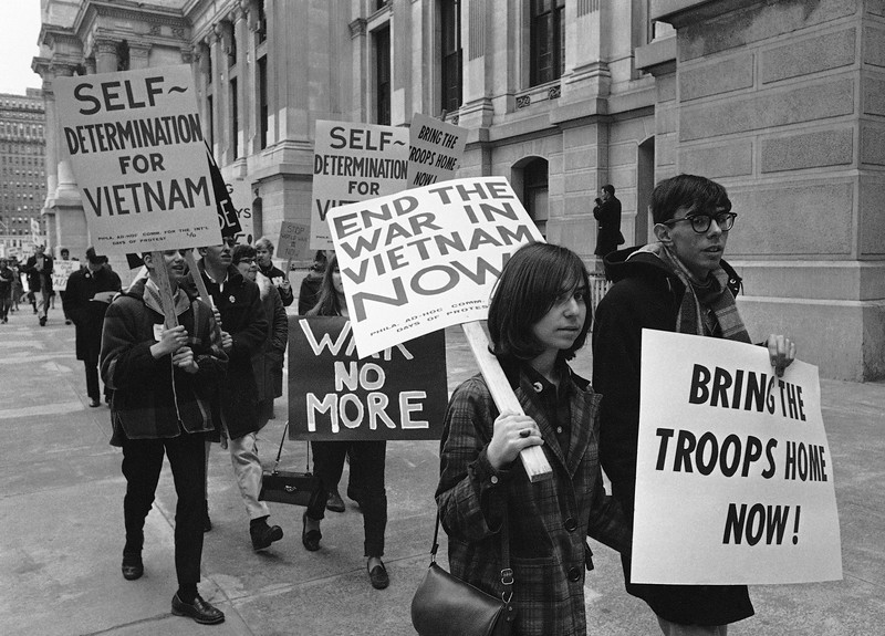 Description of  Seen here are pickets demonstrating against the Vietnam War as they march through downtown Philadelphia, Pa, March, 26 1966. (AP Photo/Bill Ingraham)