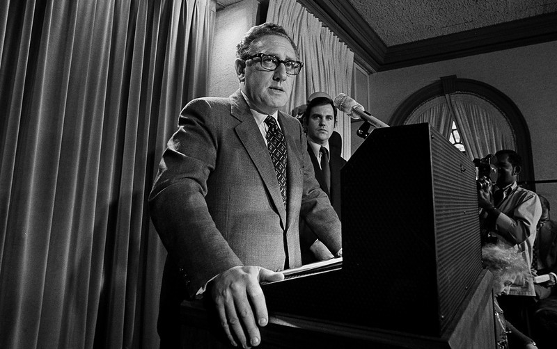 "Description of  Then presidential adviser Dr. Henry Kissinger tells a White House news conference that ""peace is at hand in Vietnam"" on Oct. 26, 1972.    (AP Photo)"