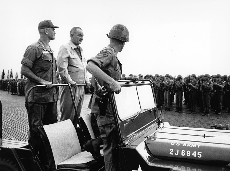 Description of  U.S. President Lydon B. Johnson reviews troops assembled in honor of his visit to the U.S. base at Cam Ranh Bay in South Vietnam on Oct. 26, 1966 during the war. Beside the President is Gen. William Westmoreland, Commander of the U.S. Military forces in Vietnam.  (AP Photo)