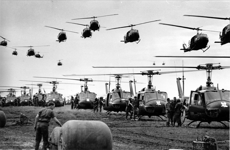 Description of  U.S. Army helicopters providing support for U.S. ground troops fly into a staging area fifty miles northeast of Saigon, Vietnam in January of 1966.  (AP Photo/Henri Huet, File)