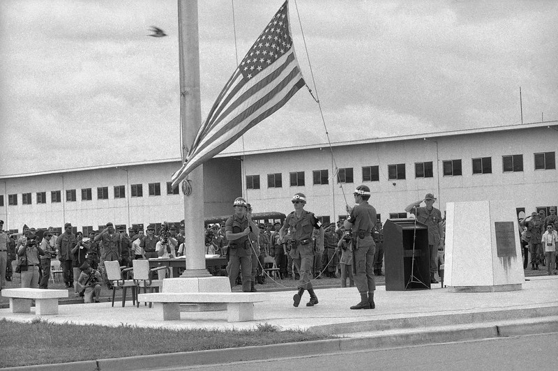 Description of  The flag comes down at the U.S. Army base at Long Binn, 12 miles Northeast of Saigon, as the base is turned over to the South Vietnamese Army, Nov. 11, 1972. It was at one time the largest American base in Vietnam with a peak of 60,000 personnel in 1969. (AP Photo)