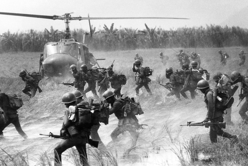 "Description of  Vietnamese soldiers of the 21st Recon Company rush to board waiting Huey choppers in the rice paddies near their forward command post in South Vietnam on Nov. 14, 1969. The men are to be transported into the interior of the U-Minh forest, the large marshy and swamp and forest area at the southern tip of Vietnam, long considered to be a VC strong-hold. For the previous month, an all Vietnamese operation called ""Operation u-minh"" had been attempting to drive the VC and NVA regulars from the area. It was the second such operation within the year. (AP Photo/Godfrey)"