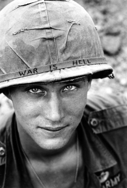"Description of  An unidentified U.S. Army soldier wears a hand lettered ""War Is Hell"" slogan on his helmet, in Vietnam on June 18, 1965. (AP Photo/Horst Faas, File)"