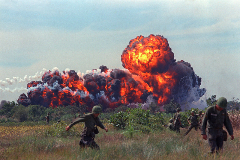 Description of  A napalm strike erupts in a fireball near U.S. troops on patrol in South Vietnam, 1966 during the Vietnam War.  (AP Photo)