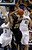 California guard Tyrone Wallace (3) and forward David Kravish (45) defend as Colorado guard Spencer Dinwiddie (25) shoots during the second half of an NCAA college basketball game in Berkeley, Calif., Saturday, March 2, 2013. California won 62-46. (AP Photo/Jeff Chiu)
