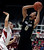 Colorado's Askia Booker, right, shoots over Stanford's Aaron Bright during the first half of an NCAA college basketball game Wednesday, Feb. 27, 2013, in Stanford, Calif. (AP Photo/Ben Margot)