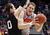 Harvard guard Laurent Rivard (0) defends New Mexico forward Cameron Bairstow (41) during the first half of their second round NCAA tournament basketball game in Salt Lake City, Utah, March 21, 2013. REUTERS/Jim Urquhart