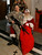 A US soldier  poses as she sits on a lap of man dressed as Santa Claus at al-Faw palace at Camp Victory at the airport in Baghdad, Iraq, Monday, Dec. 15, 2008.  (AP Photo/Khalid Mohammed)