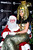 Heidi Klum, dressed as Cleopatra, poses with Santa Claus during her Haunted Holiday Party benefiting Superstorm Sandy relief efforts, on Saturday, Dec. 1, 2012 in New York. Klum's original party, scheduled to be held on Halloween, was postponed due to the storm. (Photo by Charles Sykes/Invision/AP)