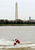 Dressed as Santa Claus, Kerry Nistel water-skis past the Washington Monument on the frigid waters of the Potomac River December 24, 2004 in Arlington, Virginia. This is the 19th year Nistel has dressed as Santa and water-skied on Christmas Eve.  (Photo by Mark Wilson/Getty Images)