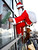 Junya Kono, left, and Tomoharu Fujimaki, window cleaner dressed as Santa Claus and reindeer clean a window at a shopping mall in Tokyo, Japan, Wednesday, Dec. 23, 2009. (AP Photo/Shizuo Kambayashi)