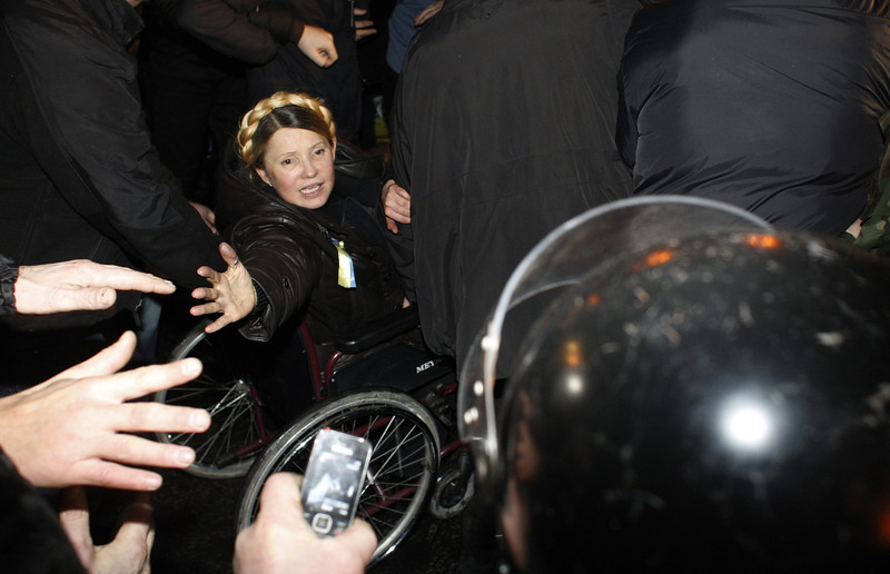 "Description of  Newly freed Ukrainian opposition icon Yulia Tymoshenko greets people as she arrives to speak at Independence Square on February 22, 2014, moments after parliament voted to hold early presidential elections in May. Ukraine's opposition leader and former premier Yulia Tymoshenko, sentenced to a seven-year jail term in 2011 for abuse of power, was released on February 22. Tymoshenko received a rapturous welcome on Independence Square. ""You are heroes, you are the best of Ukraine,"" she told the 50,000-strong crowd before breaking down in tears. The latest developments in the ex-Soviet nation's three-month political crisis came after protesters took control of Kiev's charred city centre and seized Yanukovych's lavish residence on a day of dramatic twists and turns.  ANOVANATOLII STEPANOV/AFP/Getty Images"