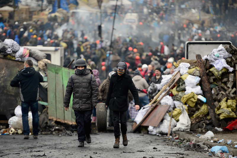 Description of  Anti-government protesters rebuild barricades following continued clashes with police in Independence square, despite a truce agreed between the Ukrainian president and opposition leaders on February 20, 2014 in Kiev, Ukraine. After several weeks of calm, violence has again flared between police and anti-government protesters, who are calling to oust President Viktor Yanukovych over corruption and an abandoned trade agreement with the European Union  (Photo by Jeff J Mitchell/Getty Images)