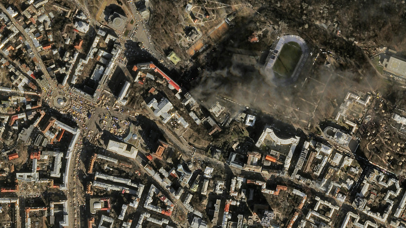 Description of  In this satellite image provided by Skybox Imaging and taken by SkySat-1 on Tuesday, Feb. 18, 2014 at 11:10 a.m. local time, smoke rises from the site of anti-government protests, upper center, in Kiev, Ukraine. Thousands of riot police armed with stun grenades and water cannons attacked the sprawling protest camp in the center of Kiev on Tuesday, following a day of street battles that left 18 people dead and hundreds injured. (AP Photo/Skybox Imaging)