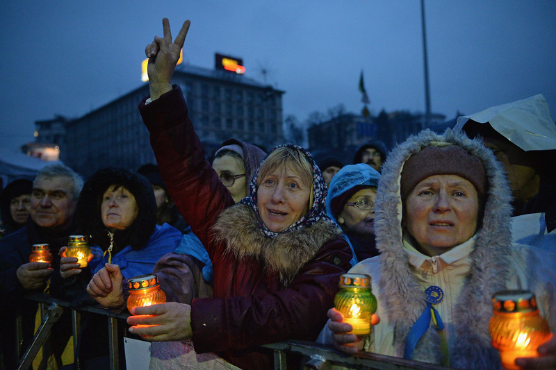 Description of  KIEV, UKRAINE - FEBRUARY 22:  People react Independence square following the announcement that Ukrainian MPs voted to oust President Viktor Yanukovych on February 22, 2014 in Kiev, Ukraine. Ukrainian members of parliament have voted to oust Viktor Yanukovych and bring presidential elections forward to the 25th of May.  (Photo by Jeff J Mitchell/Getty Images)
