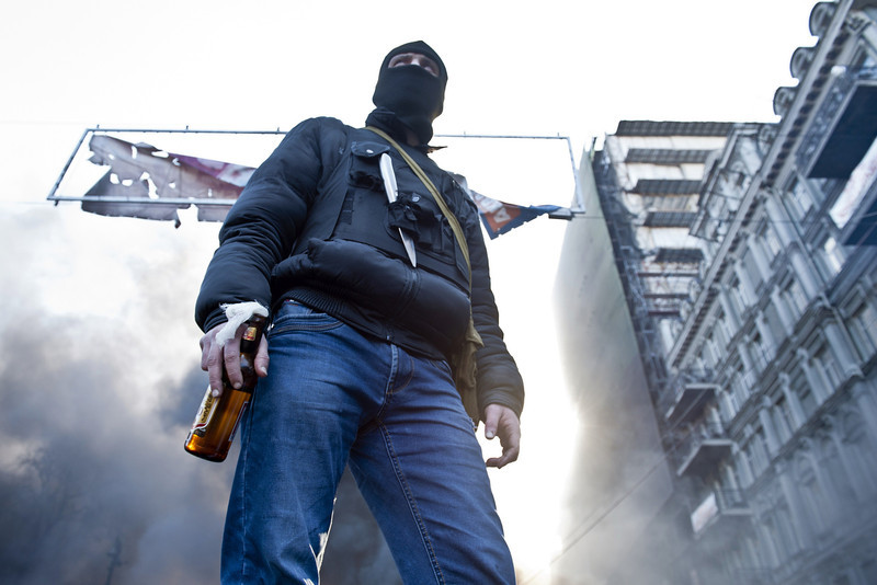 "Description of  An opposition demonstrator holds a Molotov cocktail  during clashes with police in Kiev on February 18, 2014. Opposition leader Vitali Klitschko on Tuesday urged women and children to leave the opposition's main protest camp on Kiev's Independence Square, known as Maidan, as riot police massed nearby. ""We ask women and children to quit Maidan as we cannot rule out the possibility that they will storm (the camp),"" the former heavyweight boxing champion told protestors on the square.  (PIERO QUARANTA/AFP/Getty Images)"