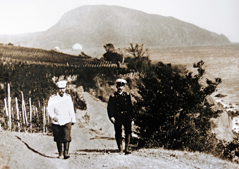 Description of  MASSANDRA, UKRAINE:  A picture taken at the beginning of the 19th century shows the last Russian Tsar and founder of the Massandra winery Nicolas II (L) walking along his vineyards in Massandra, not far from the Crimean resort of Yalta. MASSANDRA WINERY/AFP/Getty Images