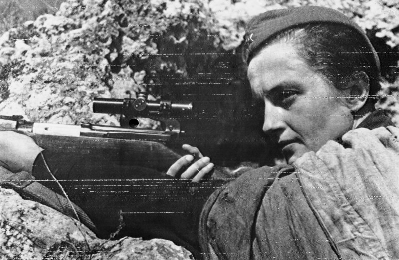Description of  The rock-like defence of Sevastopol, the Malta of the Crimea, on June 12, 1942, shows no signs of weakening under a new all-out offensive by General von Mannheim's armies. Symbolic of the heroic garrison is this Russian girl sniper, Lyudmila Pavlichenko, who has killed by her accurate shooting the magnificent total of 300 Germans before Sevastopol. (AP Photo)