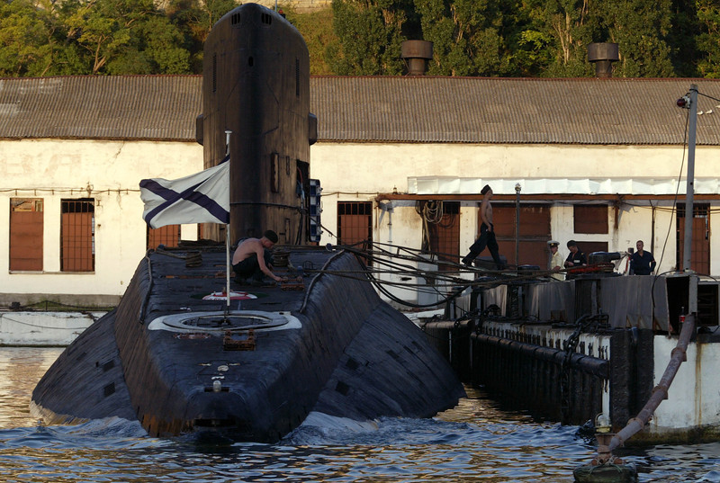"Description of  SEVASTOPOL, UKRAINE - AUGUST 15:  Russian sailors tend to a ""Varshavyanka"" submarine August 15, 2003 in Sevastopol, Crimea in the Ukraine. Sevastopol is the main base of the Russian Black Sea Fleet. Russia and the Ukraine have an agreement keeping the base in Sevastopol through 2017.  (Photo by Oleg Nikishin/Getty Images)"