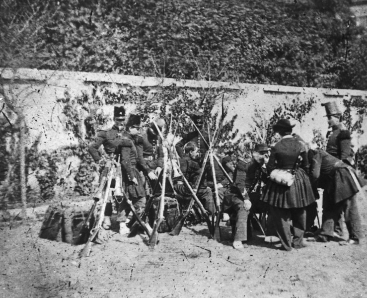Description of  A French vivandiere, or cantiniere, with French soldiers in the Crimea during the Crimean War, 1855. Vivandieres were women attached to regiments as canteen keepers and as unofficial nursing staff. (Photo by Hulton Archive/Getty Images)