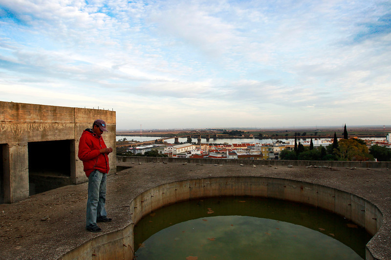 "Description of  An unfinished pool collects rain water on the top of the condo building where Maciel used to dry his clothes. In mid-January he will fly to England in search of work. ""In Portugal there is no more hope for better days,"" he says.  (Photo by Bruno Colaço, Special to The Denver Post)"