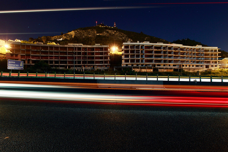 Description of  The Bella Guarda condo can be seen by any driver who travels to Lisbon or to Porto from the main motorway. Like many other unfinished buildings in Portugal this is a reflexion of a country with a stagnate economy. (Photo by Bruno Colaço, Special to The Denver Post)