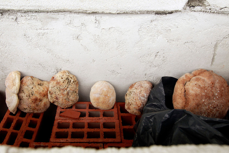 "Description of  Ivan puts the bread that he doesn't eat outside the window of his ""room"" but it ends up growing mold because it is exposed to the elements.  (Photo by Bruno Colaço, Special to The Denver Post)"