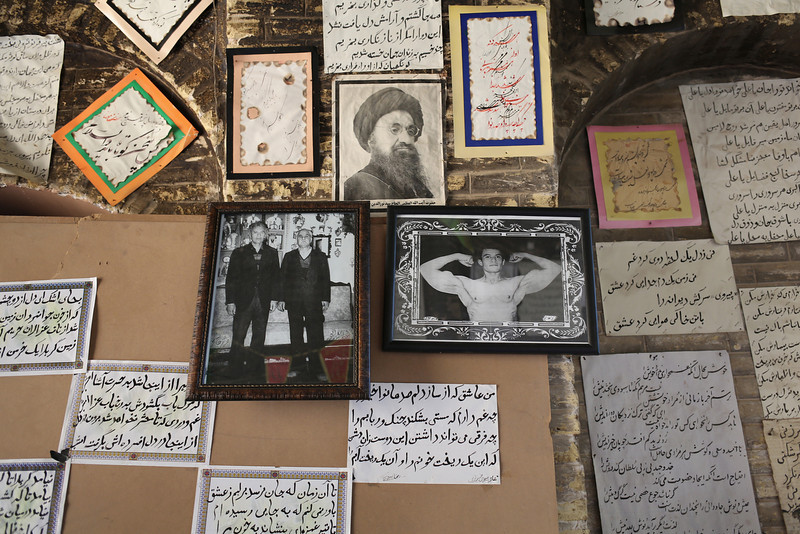 Description of  SHIRAZ, IRAN - MAY 29:  Photos and poems adorn the entrance of a calligraphy workshop on May 29, 2014 in Shiraz, Iran. Shiraz, celebrated for more than 2,000 years as the heartland of Persian culture, is known as the home of Iranian poetry and for its progressive attitudes and tolerance. Like all of Iran, this week Shiraz observes the 25th anniversary of the death and continued legacy of the Ayatollah Khomeini, the father of the Islamic revolution.  (Photo by John Moore/Getty Images)
