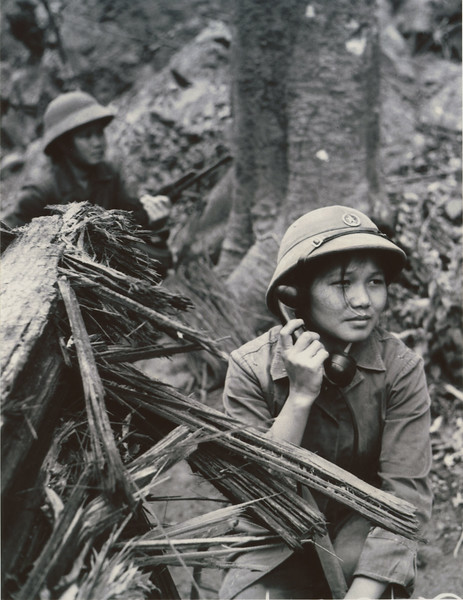 Description of  A radio operator with the North Vietnamese Army on the Ho Chi Minh Trail. © Hua Kiem