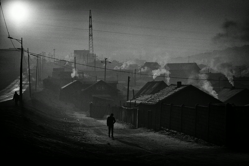 Description of  Winter in Bayan Khoshuu, a poor district known as the yurt neighborhood, in Ulan Bator. Winter temperatures go down to  40° or  50º C ( 40°/ 60° F) forcing thousands to burn vast quantities of coal for heating, leaving a thick cloud of smoke over the city, and causing serious diseases from air pollution. In winter Ulan Bator is one of the most polluted cities in the world.<br />© Olivier Laban-Mattei / The Mongolian Project / MYOP