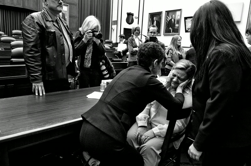 """Description of  Sergeant Jennifer Norris was 21 when she joined the US Air Force, and was drugged and raped by her recruiter at Lackland Air Force Base in San Antonio, Texas. Nancy Parrish, President of the association """"Protect Our Defenders,"""" is seen comforting her after she testified at the hearing of the US House Committee on Armed Services on Capitol Hill. © Mary F. Calvert / Zuma Press <br /><br />Canon Female Photojournalist Award 2013 presented by the AFJ"""