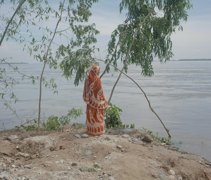 """Description of  Kurigram District, Bangladesh, 2012. <br />Severe flooding hit more than 400 000 people in Kurigram district.  Khushi, who is camping by the dam with her family, can only reflect on the loss while the flood takes its toll. From the series """"Life on Water – Bangladesh Floods.""""<br />""""This award gave me great exposure in the photography world"""" © Rasel Chowdhury, Ian Parry Scholarship Winner 2011"""