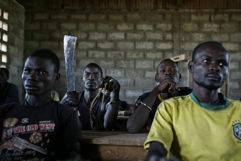 Description of  Central African Republic, December 15, 2013. <br />Men from the Popular Rebel Movement of the Central African Armed Forces [Mouvement de révolte des forces armées centrafricaines pour le peuple], a mainly Christian group, being given military training in a school in a suburb of Bangui. © Michaël Zumstein / Agence VU for Le Monde