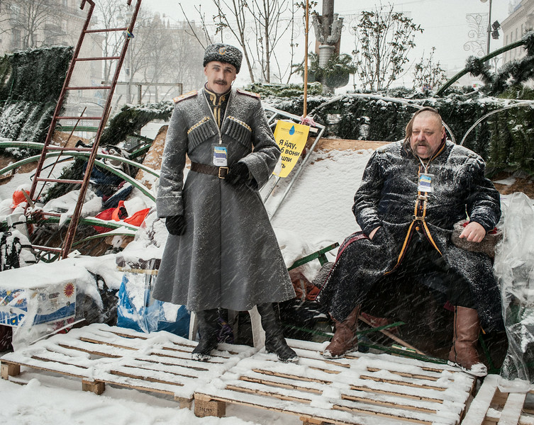 Description of  Kiev, Khreshchatyk Avenue, December 9, 2013, 9.29 am.Two Cossacks on a barricade manned by pro-EU activists near Independence Square. © Guillaume Herbaut / Institute